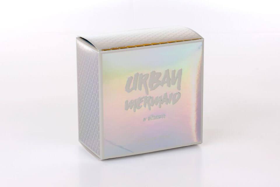 Caja plegadiza metalizada y con barniz UV a registro.